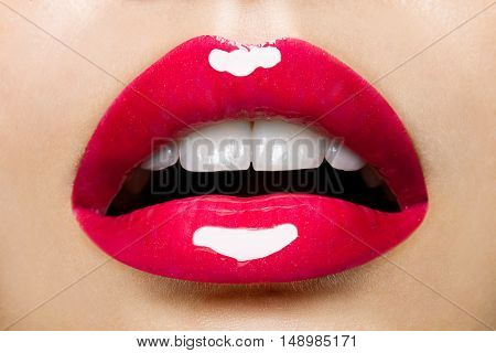 Beautiful red female plump lips with glitter