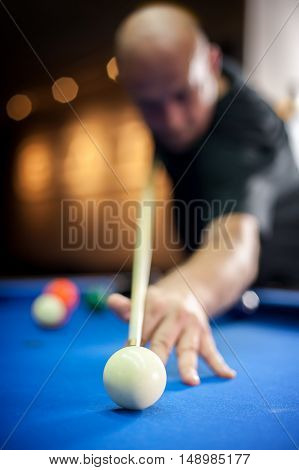 Young Man Playing Pool Game In Pub