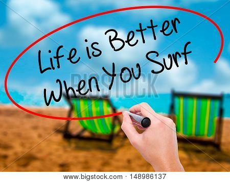 Man Hand Writing Life Is Better When You Surf With Black Marker On Visual Screen.