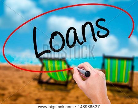Man Hand Writing Loans  With Black Marker On Visual Screen