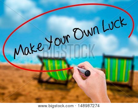 Man Hand Writing Make Your Own Luck With Black Marker On Visual Screen