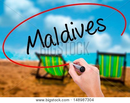 Man Hand Writing Maldives  With Black Marker On Visual Screen