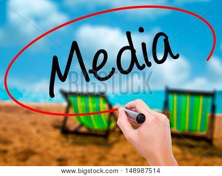 Man Hand Writing Media With Black Marker On Visual Screen
