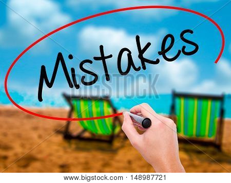 Man Hand Writing  Mistakes With Black Marker On Visual Screen