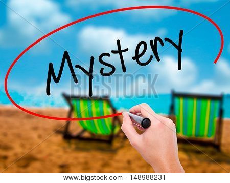 Man Hand Writing Mystery With Black Marker On Visual Screen.