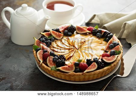 French apple tart decorated with fresh berry and figs