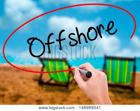 Man Hand Writing Offshore With Black Marker On Visual Screen