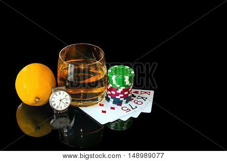 Cards with colorful chips to poker and tumbler whiskey with watch
