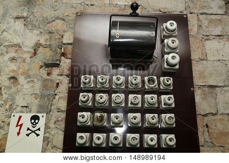 old electric panel box- plugs and fuses