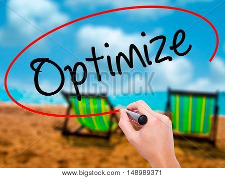 Man Hand Writing Optimize With Black Marker On Visual Screen