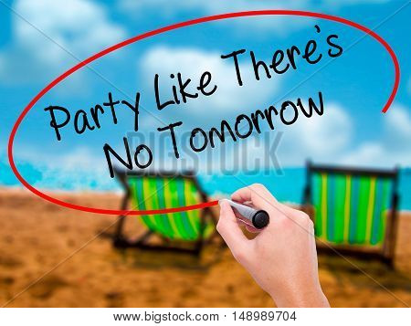 Man Hand Writing Party Like There's No Tomorrow With Black Marker On Visual Screen.
