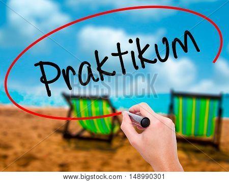 Man Hand Writing Praktikum (internship In German)  With Black Marker On Visual Screen