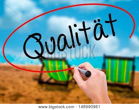Man Hand Writing Quality (qualitat In German) With Black Marker On Visual Screen