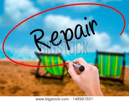 Man Hand Writing Repair With Black Marker On Visual Screen