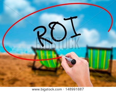 Man Hand Writing Roi (return On Investment)  With Black Marker On Visual Screen