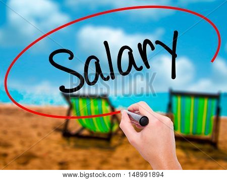 Man Hand Writing Salary  With Black Marker On Visual Screen
