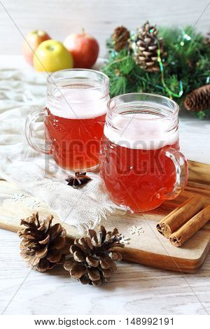 Two mugs of winter craft beer and New Year decorations