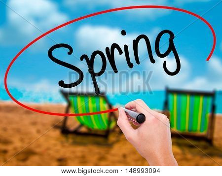 Man Hand Writing Spring With Black Marker On Visual Screen.