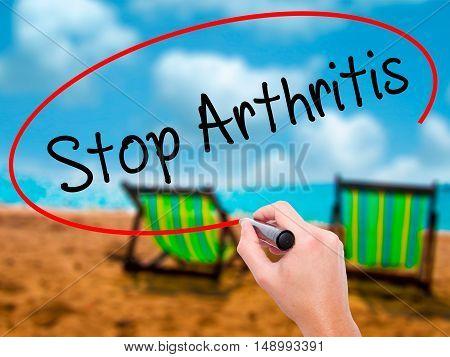 Man Hand Writing Stop Arthritis With Black Marker On Visual Screen