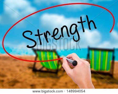 Man Hand Writing Strength With Black Marker On Visual Screen