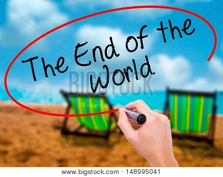 Man Hand Writing The End Of The World With Black Marker On Visual Screen