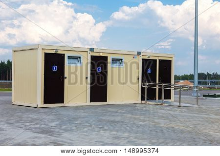 TVER REGION RUSSIA - JUNE 26 2016: New modular public toilet stand on the pavement