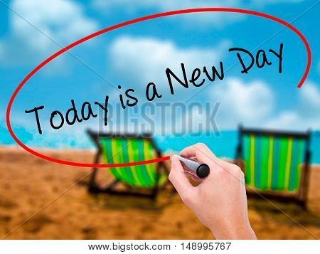 Man Hand Writing Today Is A New Day With Black Marker On Visual Screen