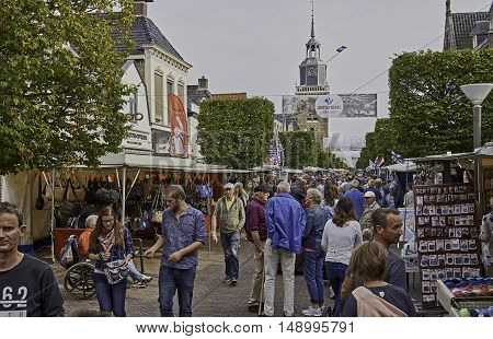 JOURE, THE NETHERLANDS - SEPTEMBER 22, 2016: Photo of annual Jouster Merke, the oldest fair and market of the world, 550 years, with stalls and a crowd of people.