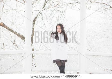 Sweet Pretty Girl In White Sweater In A Winter