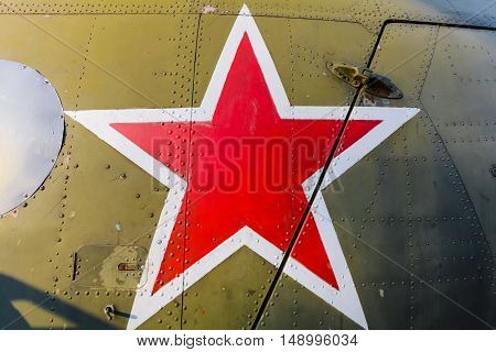 The red star on the green armor of military plane . Red Star is the symbol of Russian Air Force