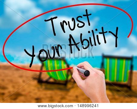 Man Hand Writing Trust Your Ability  With Black Marker On Visual Screen