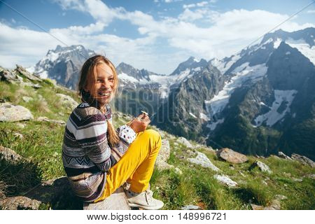 Pre teen child resting on the top of the mountain, alpine view