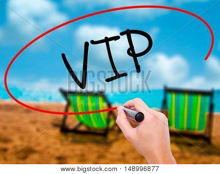 Man Hand Writing  Vip With Black Marker On Visual Screen