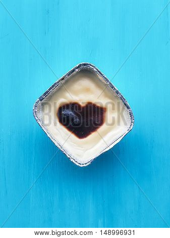 baked rice pudding sutlac on a turquoise background