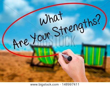 Man Hand Writing What Are Your Strengths? With Black Marker On Visual Screen