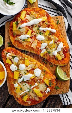 Homemade hawaii Flatbread Pizza with chicken and pineapple dressing yogurt sauce