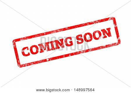 COMING SOON word written on red rubber stamp with grunge edges.