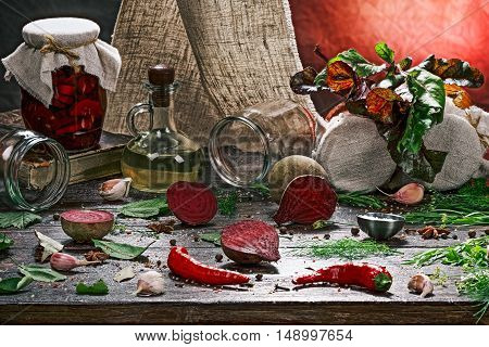 Canned beetroot on the table with vegetable and spices for preparing
