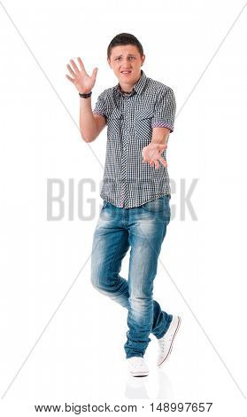 Unhappy guy standing full length, isolated on white background. Young man with arms raised.