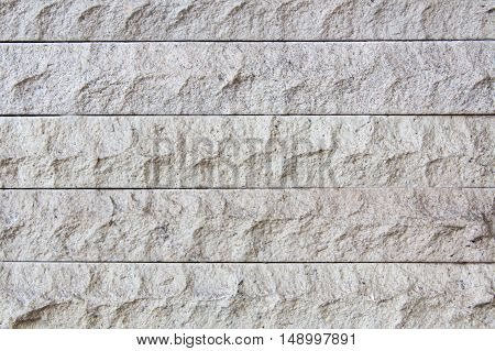 White stone brick wall texture background. flooring interior rock stone old pattern clean concrete grid uneven bricks design stack.