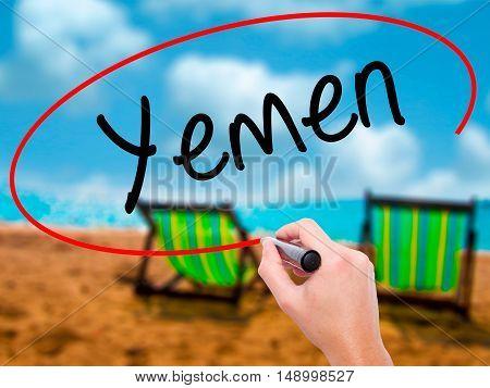 Man Hand Writing  Yemen  With Black Marker On Visual Screen