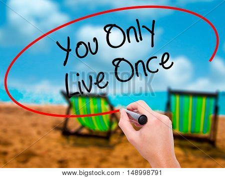Man Hand Writing You Only Live Once With Black Marker On Visual Screen