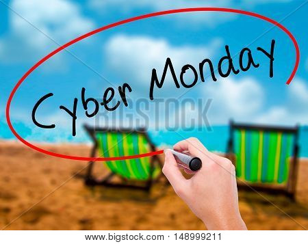 Man Hand Writing Cyber Monday With Black Marker On Visual Screen