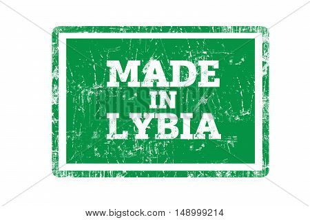MADE IN LYBIA word written on rubber stamp and flag with grunge edges.