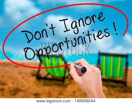 Man Hand Writing Don't Ignore Opportunities Black Marker On Visual Screen