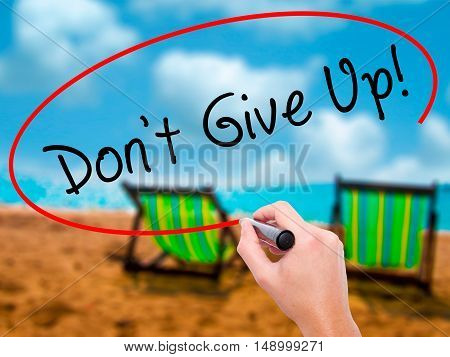 Man Hand Writing Don't Give Up With Black Marker On Visual Screen