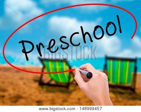 Man Hand Writing Preschool With Black Marker On Visual Screen