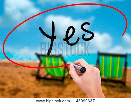 Man Hand Writing Yes With Black Marker On Visual Screen