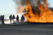 stock photo of firehose  - Firefighters train for battling an aircraft fire - JPG