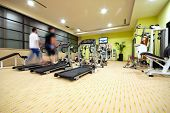 image of gym workout  - Man running on treadmill in gym - JPG